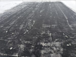 After the snow thrower, add salt and it clears the driveway.