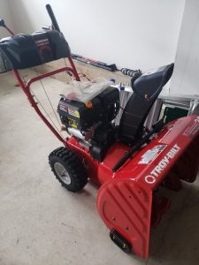 A side view of the Troy-Bilt snow blower.