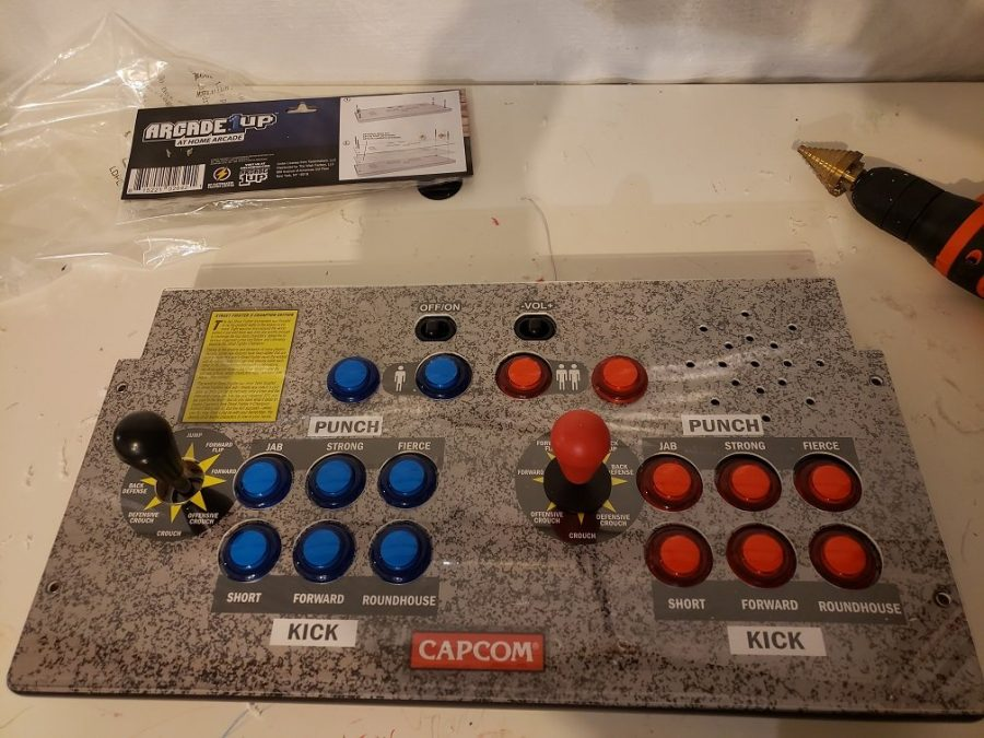 Arcade1up drilling holes for the control panel.