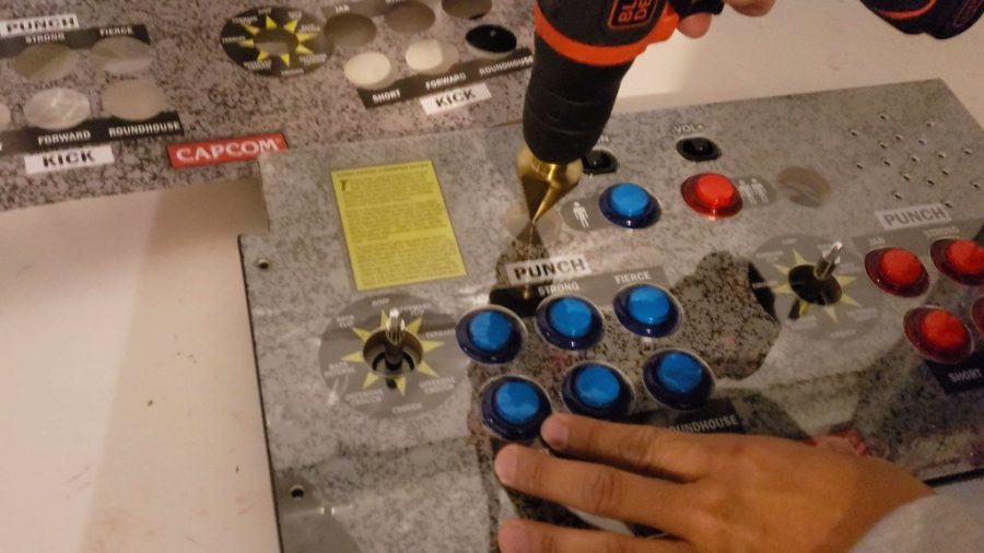 Arcade1up drilling the plexiglass right in the center.