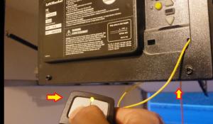 Pressing the remote for the Klik1 garage door opener.